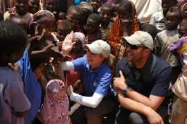 Mindy Mizell practices 'high-fiving' children at one of the refugee camps in the Horn of Africa.